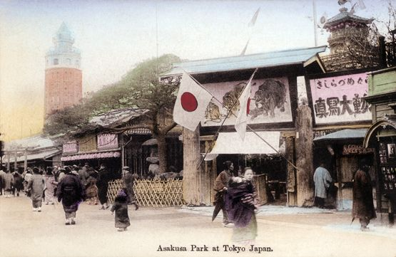 Crowd walks past the Nakamise shops along the approach to Sensoji, a Buddhist temple in Tokyo's Asakusa district, ca. May 1934.